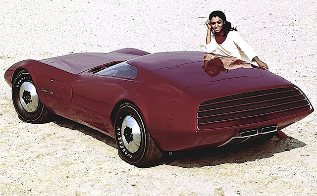 a purple or wine colored 1968 Dodge Charger concept car with a pretty woman
