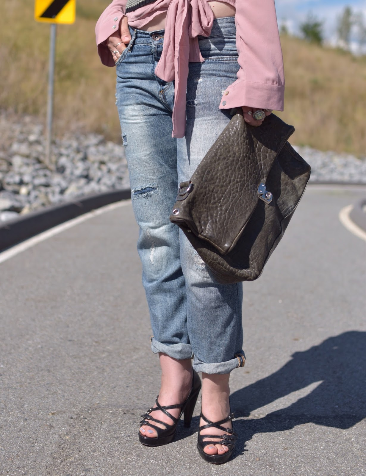 dusty rose front-tied blouse, boyfriend jeans, strappy shoes, slate blue satchel