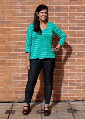 Liana Stretch Jeans in black denim modeled against a brick wall.