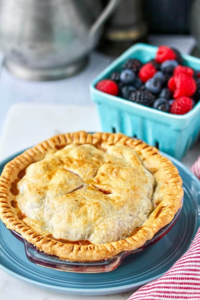 Mini berry pie with a mixture of four different berries baked in an air fryer.