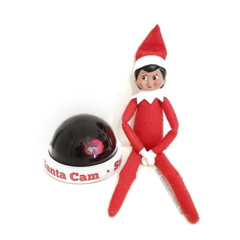 elf with santa surveillance camera