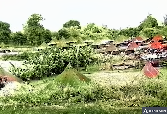 Enlisted men's tent quarters, Base R 1945.  Image source:  United States National Archives.  Colorized courtesy of Algorithmia.