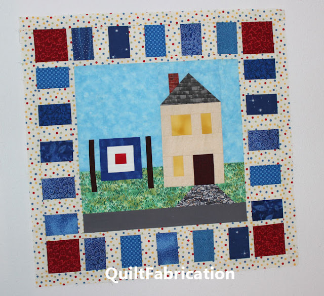 house with a quilt on the laudry line