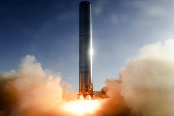 SpaceX's Super Heavy Booster 3 prototype ignites its three Raptor engines during a static fire at Starbase, Texas...on July 19, 2021.