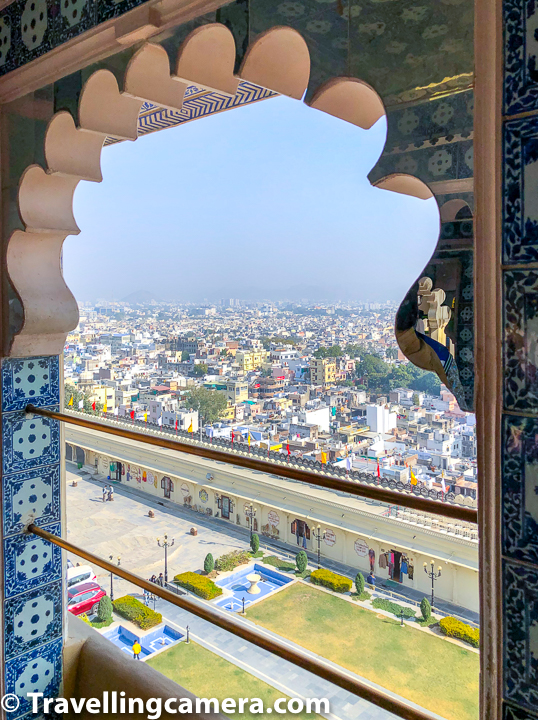 Udaipur City is visible from City Palace on one side and Lake Pichola is on other side. Above photograph shows a view of Udaipur City from City Palace window.