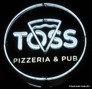 Toss Pizza neon sign