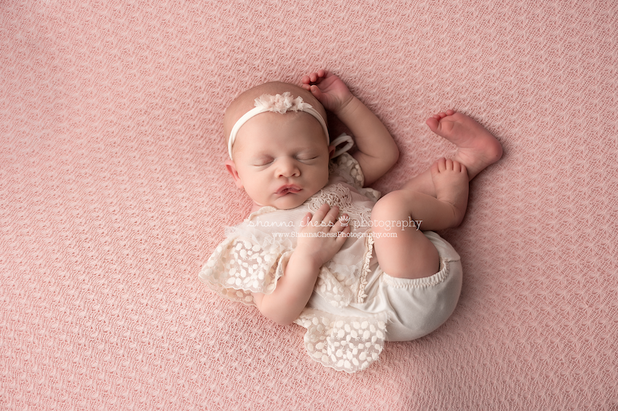Eugene, Oregon newborn photographer, infant girl on pink background