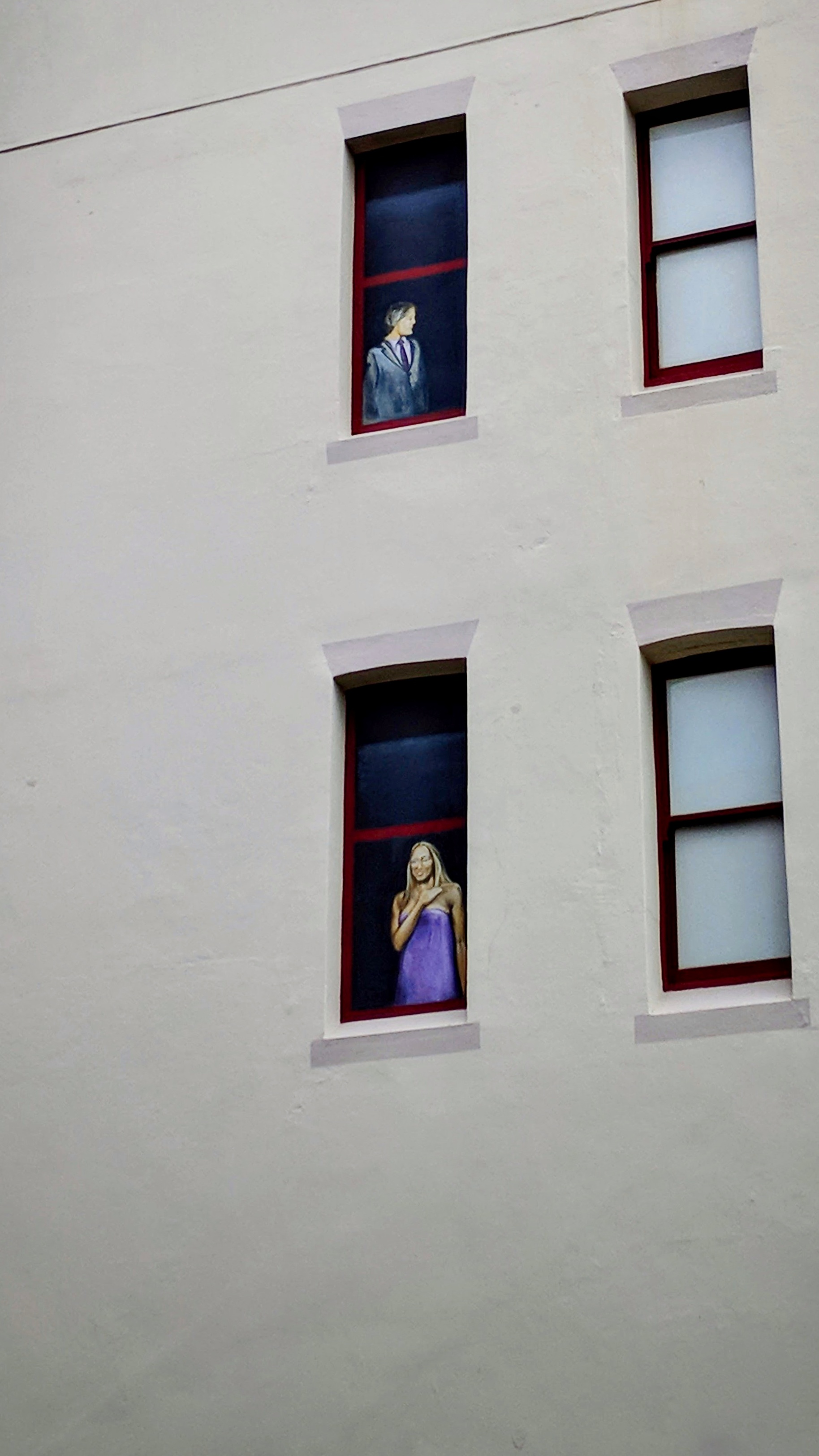 Painted window people on a building