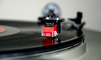 Vinyl record on turntable image