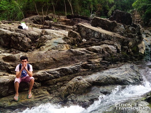 The author at the rock formation at the bank of Calinawan river