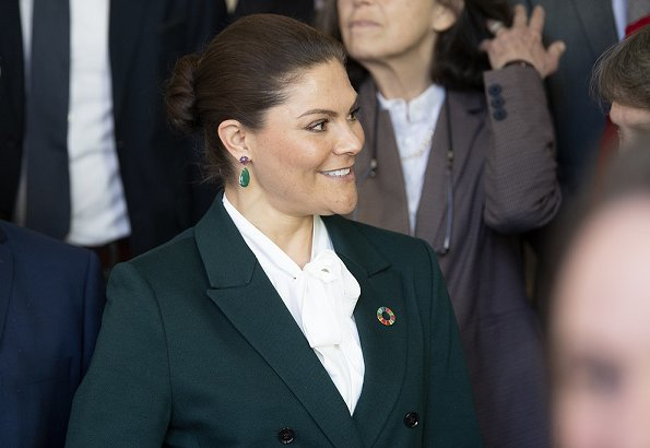 Crown Princess Victoria wore Tiger of Sweden Molena suit. Af Klingberg rakel taupe suede boots. Caroline Svedbom green earrings