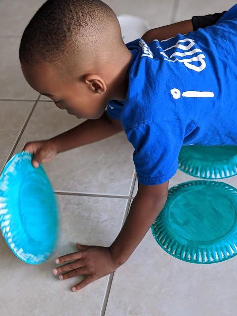 African-American boy playing Giant DIY Spring Matching Game
