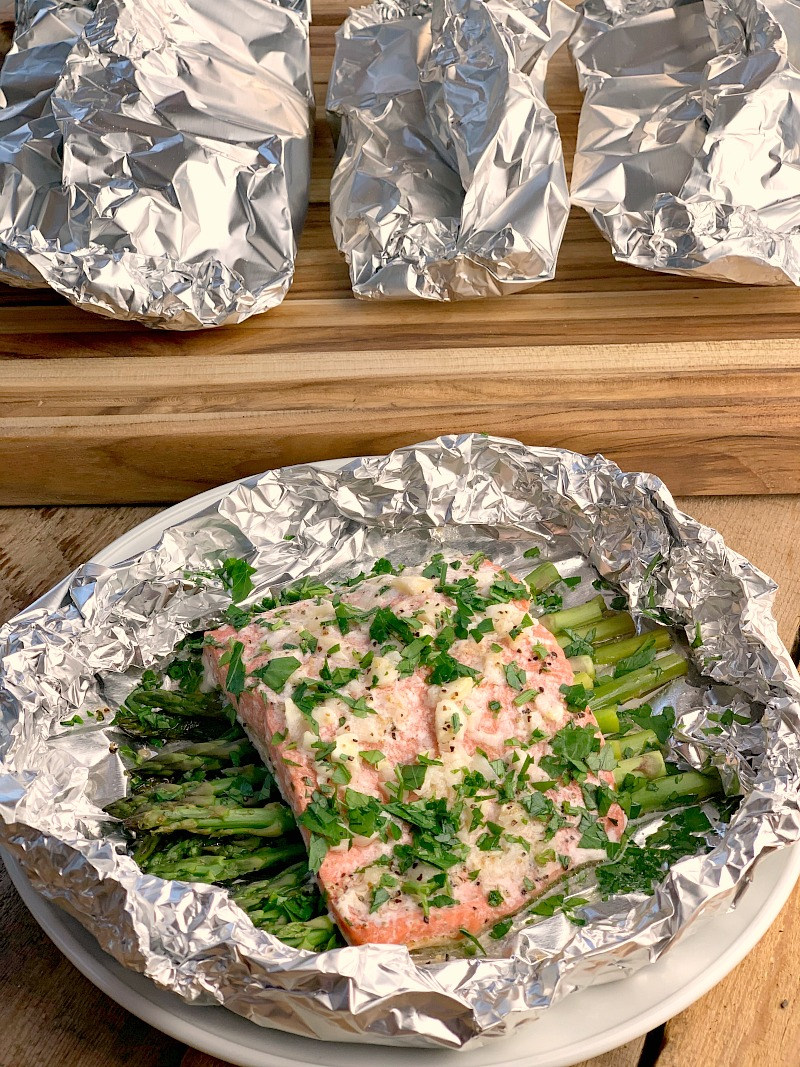 Lemon Garlic Salmon Foil Packs - Conquer your fear of grilling fish with this easy to make recipe for Lemon Garlic Salmon in foil. Delicious and easy to make with very little cleanup, it makes your summer grilling a breeze and will have the family begging for more! #keto #lowcarb #glutenfree #grilling #grilled #salmon #fish #seafood #lemon #garlic #easy #recipe | bobbiskozykitchen.com