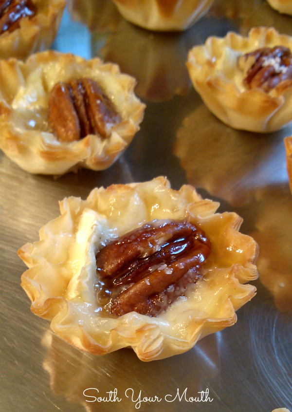 Salted Pecan Brie Tartlets with Honey Drizzle | A fun and easy appetizer recipe made with mini phyllo cups filled with creamy brie, toasty pecans and sea salt drizzled with honey.