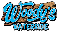 The Woody's Waterside restaurant is located in St. James City on Pine Island, Florida offering bar and grill foods in a laid back space with a unique buoy sign recreating the Key West sign.
