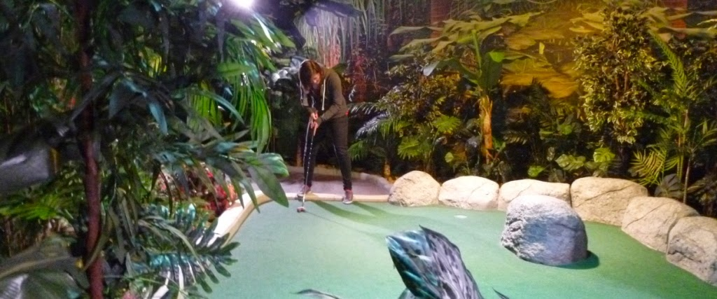 Emily Gottfried playing on the Temple Trail course at The Lost City Adventure Golf in Nottingham