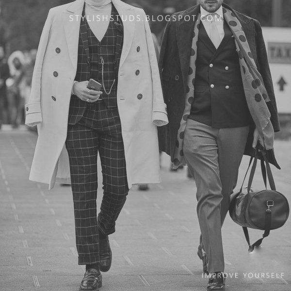 Two dandies are walking on a road