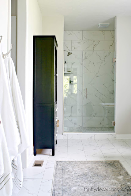 Black tall cabinet in bathroom for storage