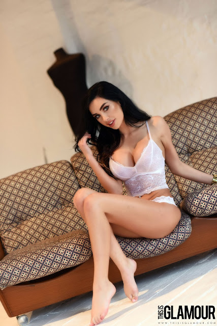 Ann Denise White Lingerie playing with hair on sofa