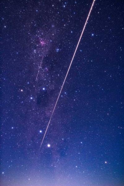 Hayabusa2's sample return capsule creates a fireball as it enters Earth's atmosphere above Woomera, Australia...on December 6, 2020 (Japan Time).