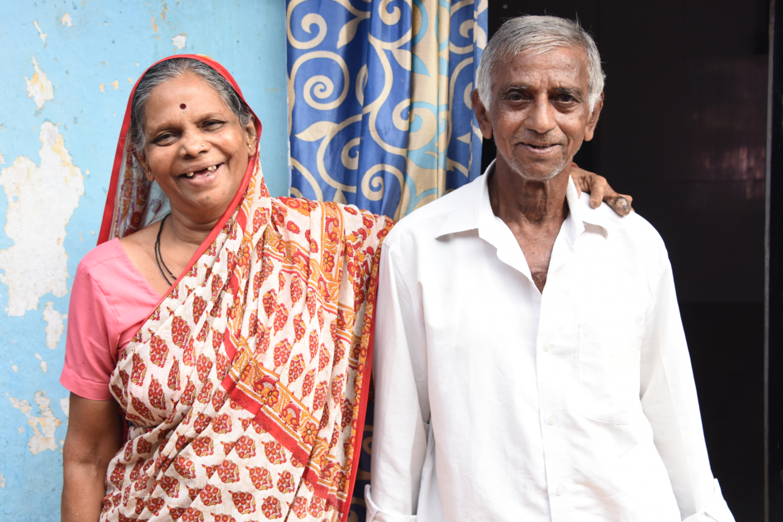 An elderly Indian couple smiling
