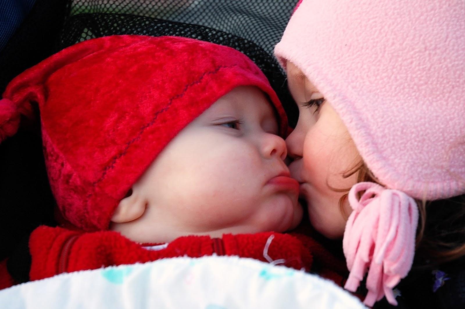 Cute babies kiss