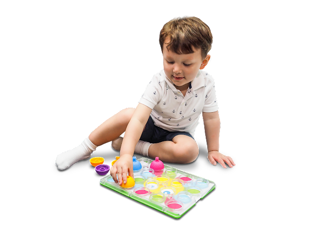 Child playing with Lalaboom peg board