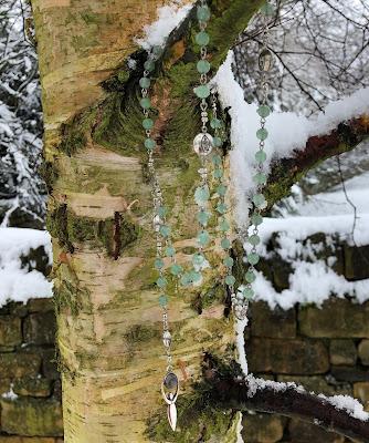 goddess freyja rosary hanging from a birch tree