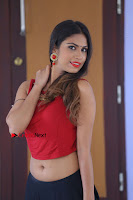 Telugu Actress Nishi Ganda Stills in Red Blouse and Black Skirt at Tik Tak Telugu Movie Audio Launch .COM 0332.JPG