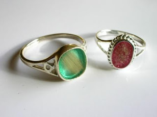 Sterling silver rings containing ashes and locks of hair