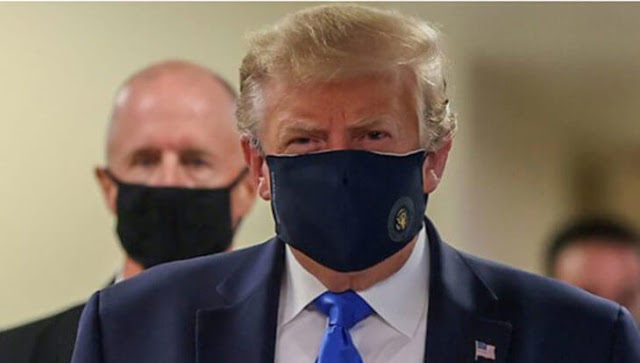 Donald trump wears facemasks in public for the first time photos
