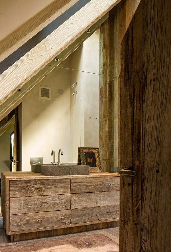 un lavabo con mueble de madera y pica de piedra es una alternativa muy atractiva para baos rsticos pequeos