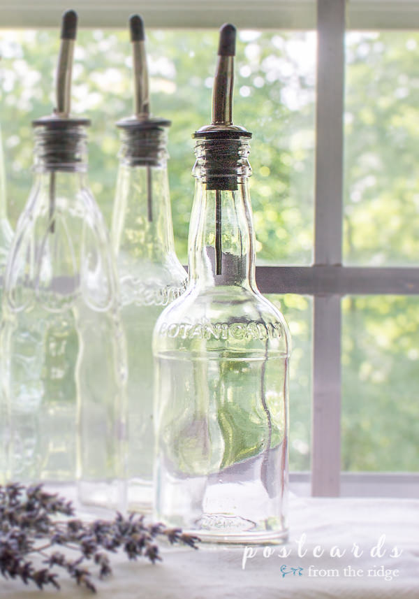 glass bottle with dispenser spout
