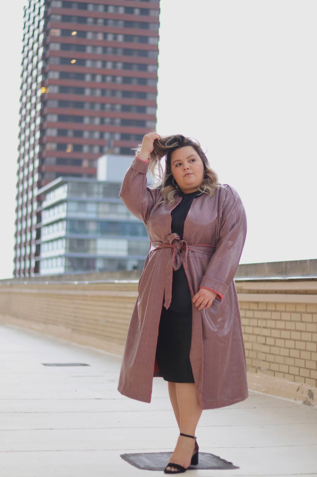 Chicago Plus Size Petite Fashion Blogger, influencer, YouTuber, and model Natalie Craig, of Natalie in the City, reviews Fashion Nova Curve's Coated Raincoat.