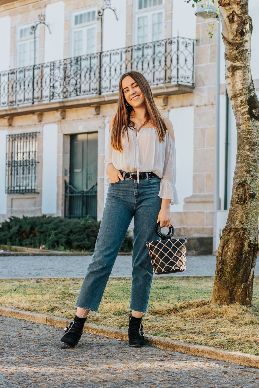 off shoulder shirt mom jeans ankle boots bucket bag outfit