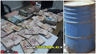 (بالصور) الحمامات : فلاح يعثر على برميل مليء بالأوراق النقدية مدفونا في ضيعته وقام  بتسليمه إلى الوحدات الأمنية