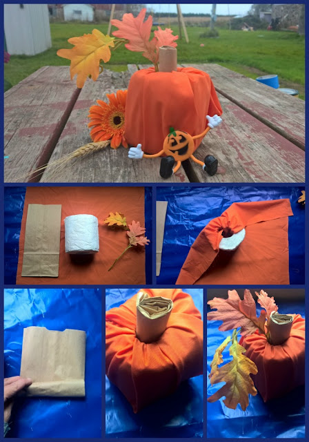 A Halloween pumpkin made with a roll of toilet paper.