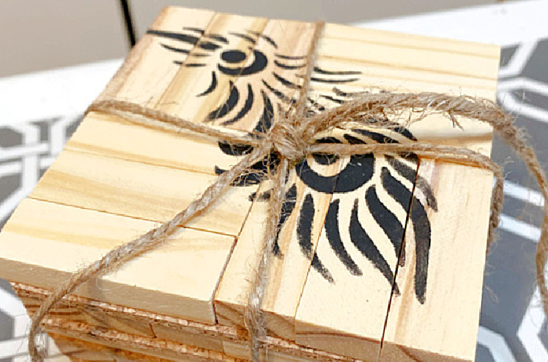 stack of coasters with feather stencil and jute tie