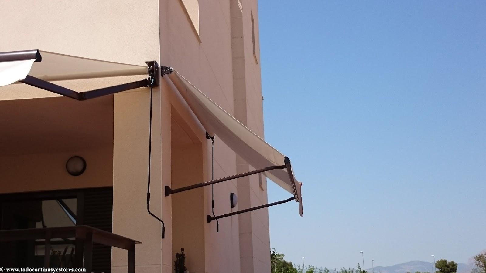 Decoracion interior cortinas verticales estores - Brazos para toldos ...
