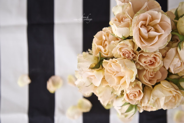 Black and white striped tablecloth with peach flowers