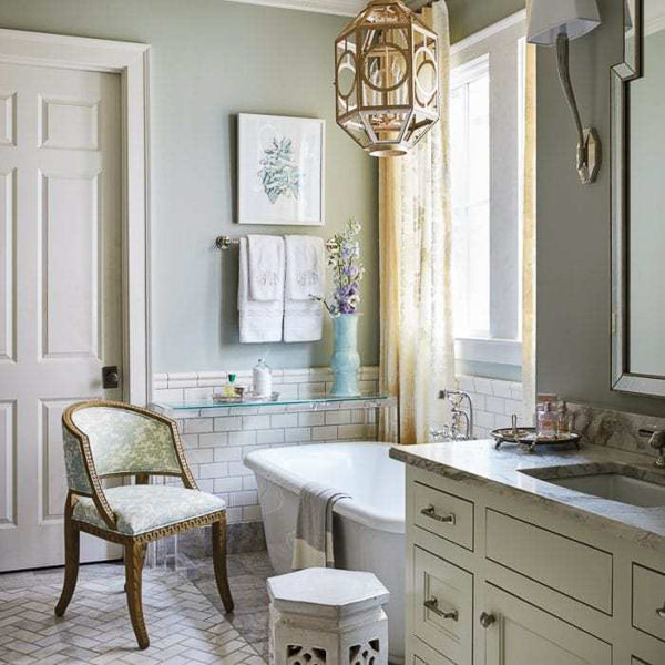 classic bathroom with Benjamin Moore Quiet Moments paint and Carrera Marble tiles