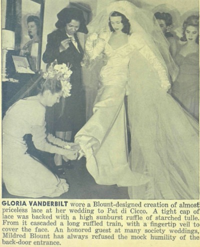 Attendant adjusting Goria Vanderbilt's shoe for 1941 wedding.