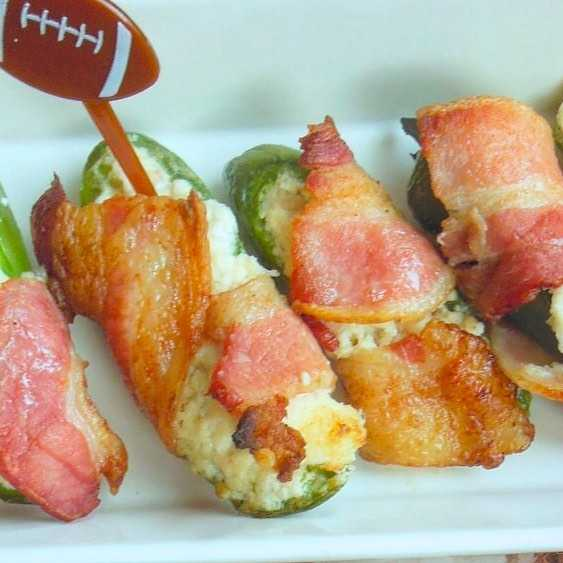 Stuffed jalapeno poppers wrapped in bacon
