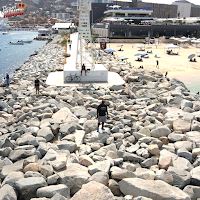 Man standing on rocks in Cabo San Lucas
