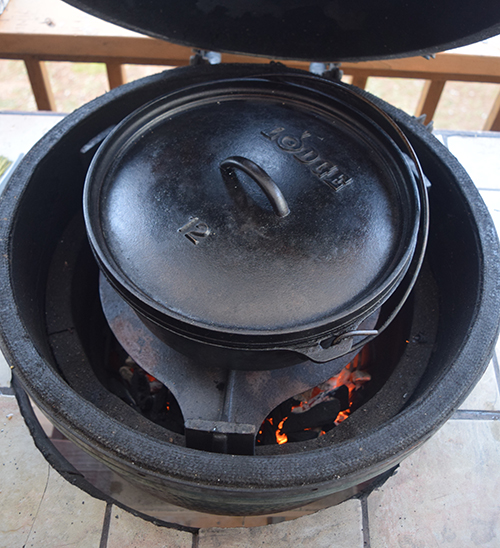 Braising a chuck roast in a Lodge dutch oven on a cast iron plate setter
