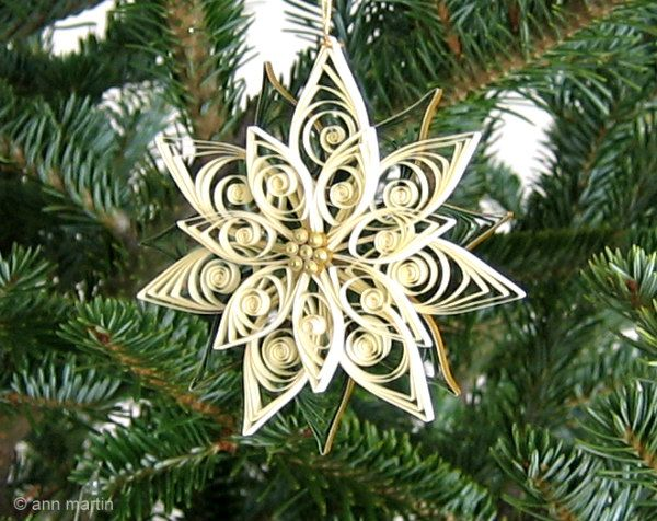 two-layer quilled poinsettia ornament hanging on christmas tree