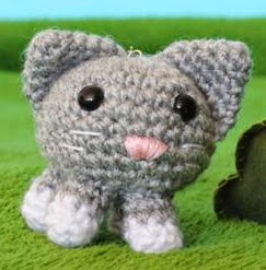 http://www.craftsy.com/pattern/crocheting/toy/kitty-got-my-key-amigurumi/30463