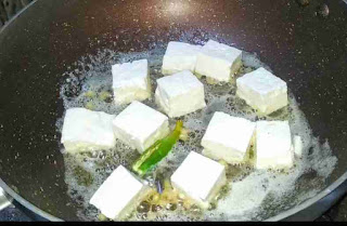Sauteeing paneer cubes with butter, ginger and green chili for Paneer makhani recipe