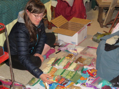 hiker sorting backpacking food
