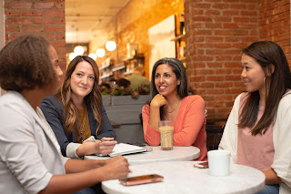 Women getting to know each other on a work outing